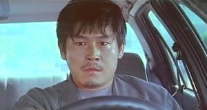Sol Kyung-gu as Kang in South Korean film Public Enemy
