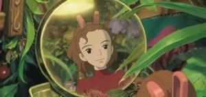 Arrietty gazes at her reflection in a bauble/Mirror