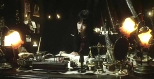 Yuko (Rin Takanashi) at Home in Her Library in Goth - Love of Death