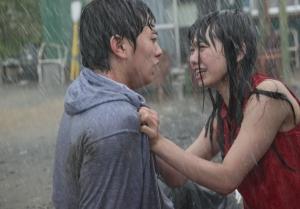 Sumida (Shota Sometani) and Keiko (Fumi Nikaido) in Himizu