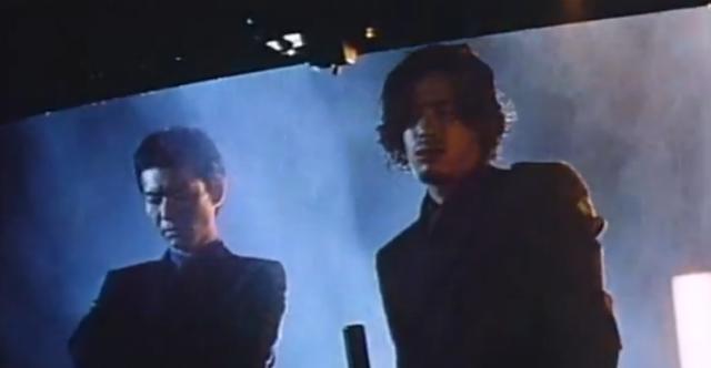 Atsuro Watabe as Reiji and Kazuma Suzuki as Goto looking at a corpse in Heat After Dark