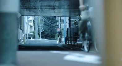 Kuon Mayo Walking Along a Street