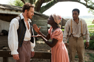 12 Years a Slave Epps (Fassbender) and Solomon (Ejiofor) Clash over Patsey (Nyongo)
