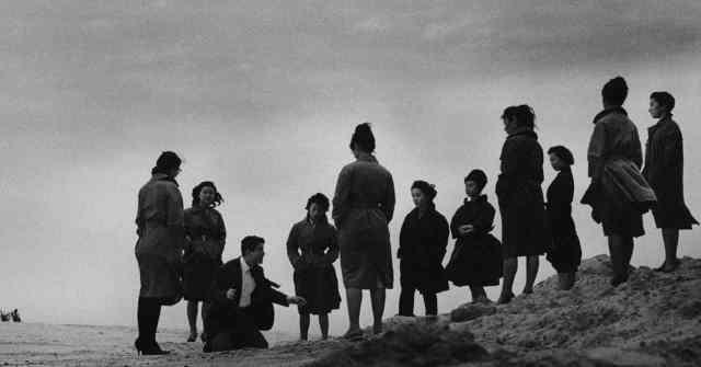 Ten Dark Women Beach Scene